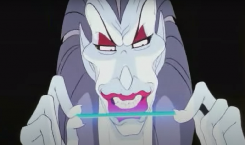 Screenshot of Mok Swagger, a character from an ill-fated animated movie called Rock n' Rule. He has excessive eyebrows, lips, and teeth, and he's holding some kind of vaporwave stick. He looks an awful lot like a cynocephalus, with the pointy ears, big curved nose, and ridiculous lips.I don't know. Ask Nelvana.
